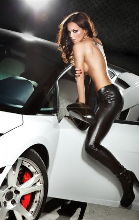 Sexy lady in front of a sport car