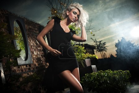 Photo for Fashionable blonde posing over evening sky - Royalty Free Image