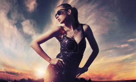 Photo for Nostalgic young beauty wearing sunglasses - Royalty Free Image