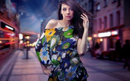 Cute brunette posing on a city street