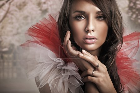 Fashion type portrait of a young beauty brunette
