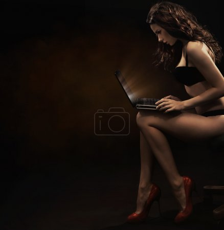 Sensual woman with laptop