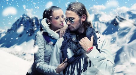 Fashionable couple posing over alpine mountains