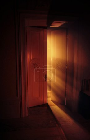 Heavenly rays of light behind the door