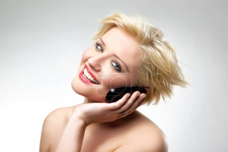 Blonde beauty speaking the phone