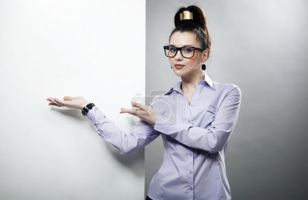 Portrait of a businesswoman pointing at the whiteboard