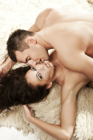 Sexy young couple lying on the bed