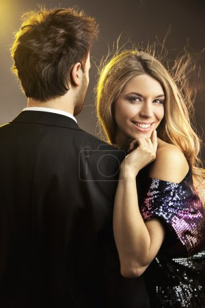 Photo for Portrait of a happy young smiling woman with her man - Royalty Free Image