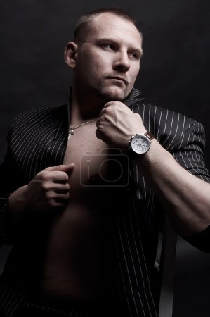 Portrait of a handsome young man with watch