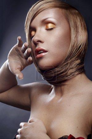 Portrait of beautiful blond woman with stylish make-up