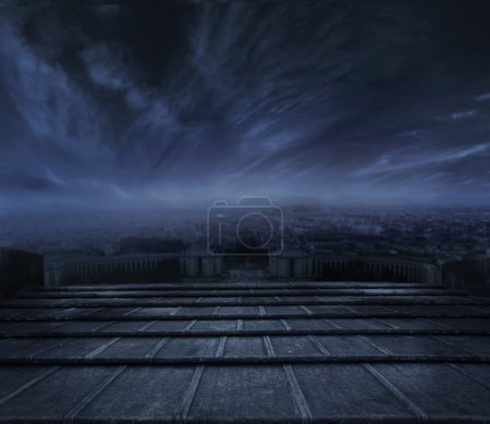 Photo for Beautiful view of town at night, Dark clouds over urban background - Royalty Free Image