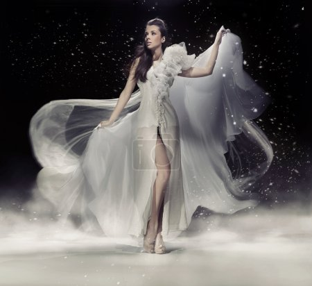 Photo for Sensual brunette woman dancing in white dress - Royalty Free Image