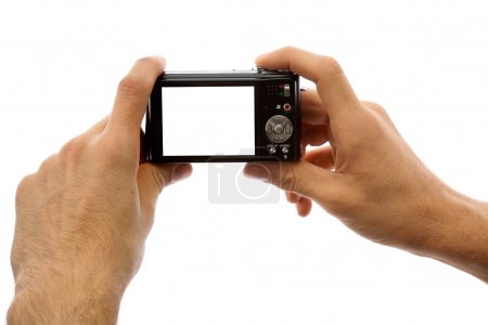 Photo for Hands of a man holding a digital camera on a white background - Royalty Free Image