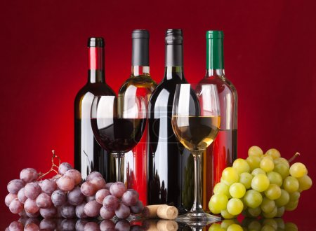 Bottles, glasses and grapes