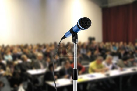 Photo for Image of microphone during seminar in a hall - Royalty Free Image