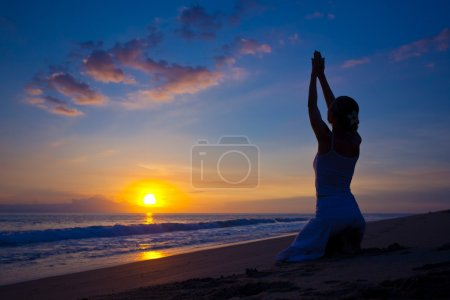 Photo for Beautiful young woman doing yoga exercise outdoors - Royalty Free Image