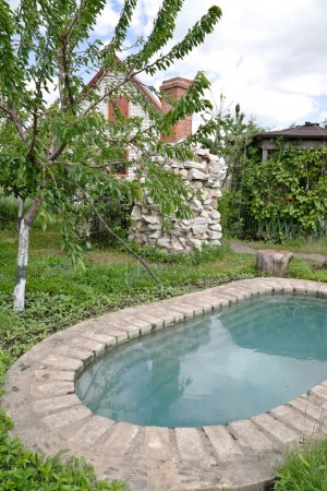 An artificial pond at the country dacha