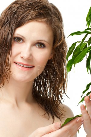 Photo for Closeup portrait of woman touching green plant with white background - Royalty Free Image
