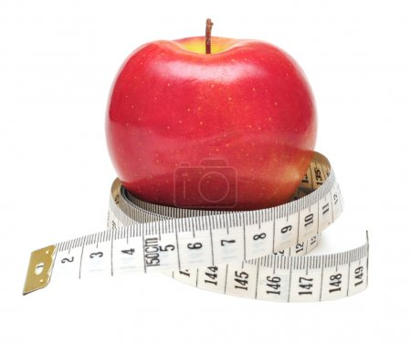 Tape measure wrapped around red apple