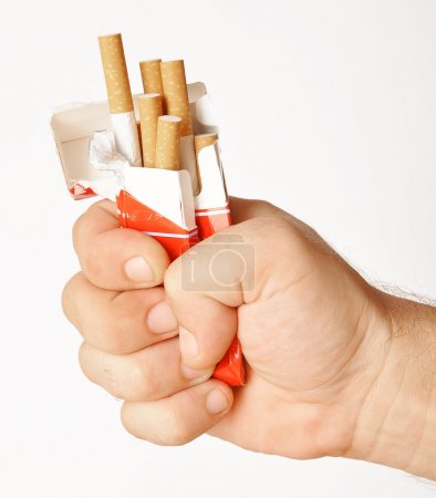 Photo for Stop smoking fist with crushed pack of cigarettes - Royalty Free Image