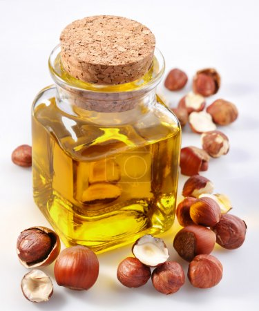 Photo for Filbert oil with nuts on a white background - Royalty Free Image