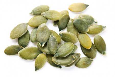 Photo for Pumpkin seeds on a white background. - Royalty Free Image