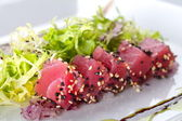 Raw fish tuna with salad frieze