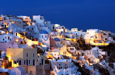 Photo for The village of Oia at dusk, on the beautiful island of Santorini, Greece - Royalty Free Image