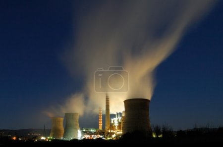 Power plant under a dusky blue sky