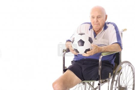 Handicap elderly man with soccer ball