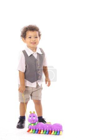 Photo pour Petit garçon avec son jouet catepillaire - image libre de droit