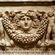 Sculptures on the marble sarcophagus in Antyalya m...