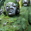 Green demons on the staircase in temple, Bali...