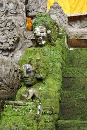 Heads of green demons on the staircase, Bali...