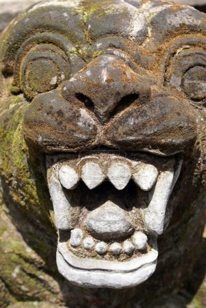Face with teeth in balinese temple, Tirta Empul, b...