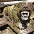 Lion guard on the staircase in Tirta Empul, Bali, ...