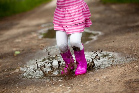 Photo for Little girl in a puddle - Royalty Free Image