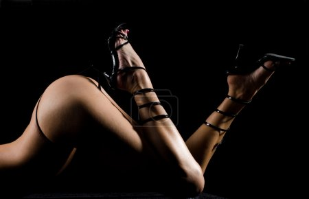 Photo for Female body with g-string and shoes with high heels - Royalty Free Image