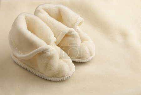 Photo for Pair of warm children slippers on a woolen texture - Royalty Free Image
