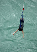 young woman bungee jumps