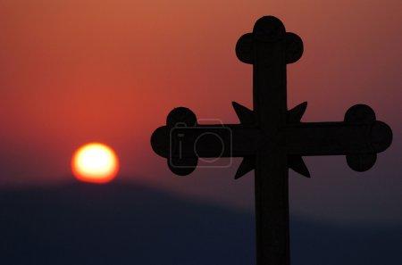 church cross over sun setting