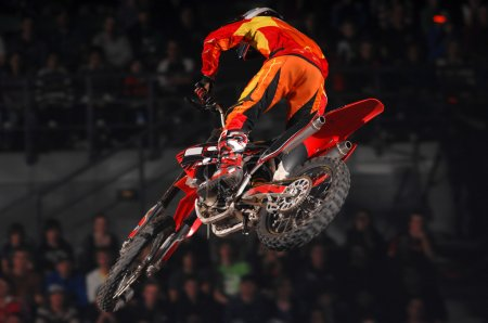 Freestyle moto-x rider during competition