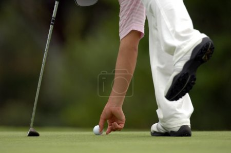 young male golfer with ball