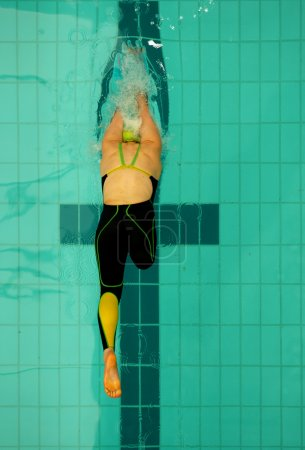 woman swimmer jumping under water