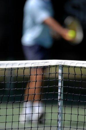 Tennis  net with defocused player