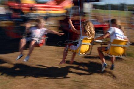 kids at swing ride