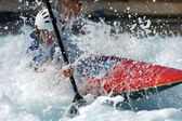 male kayaker races down