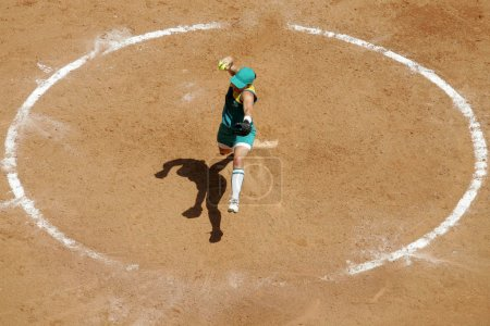 female softball player pitches ball