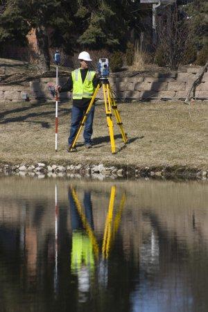 Surveyor working with robotic station