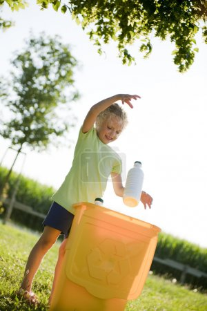 Photo for Little girl recycling - Royalty Free Image